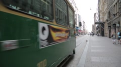 Tram trolley car passing by camera in Helsinki Stock Footage