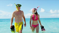 Healthy Caucasian couple at vacation beach resort with snorkels - stock footage