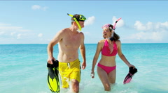 Young Caucasian couple in swimwear on Caribbean beach with snorkeling equipment Stock Footage