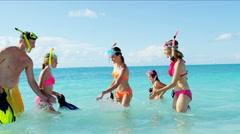 Healthy Caucasian family enjoying ocean water fun with snorkeling equipment Stock Footage