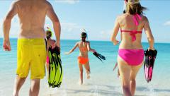 Young Caucasian family in swimwear enjoying snorkeling on a beach vacation Stock Footage