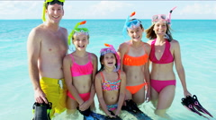 Portrait of a healthy outdoor Caucasian family in swimwear with snorkels Stock Footage