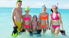 Portrait of happy Caucasian parents and young daughters enjoying snorkeling Stock Footage