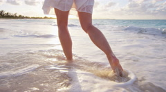 Legs of a Caucasian female with outdoor lifestyle going barefoot - stock footage