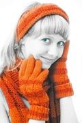 beauty girl with orange mittens - stock photo