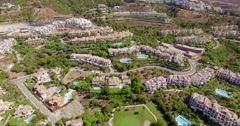 Aerial. Flight Over Houses and Golf Fields - stock footage