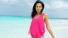 Stock Video Footage of Portrait of young African American girl on ocean vacation beach