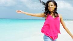 African American girl walking barefoot on ocean beach sand - stock footage