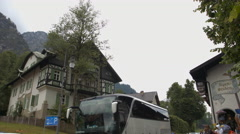 Driving bus on Alpseestrasse, in front of Alpenstuben Hotel, Neuschwanstein Stock Footage