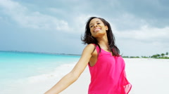 Tropical island living young African American girl on vacation - stock footage
