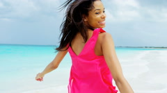 Portrait of young African American girl on vacation ocean beach - stock footage