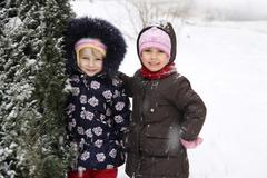 Happy girls enjoying snowy weather Stock Photos