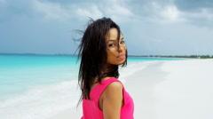 Portrait of African American girl walking on ocean sand - stock footage