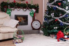 Decorated holiday home decor with fireplace and Christmas tree Stock Photos