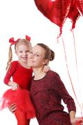 Daughter and mother with red balloons Stock Photos