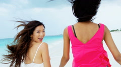 Portrait of African American Asian Chinese female on beach - stock footage