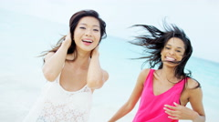 Portrait of African American Asian Chinese female on beach Stock Footage