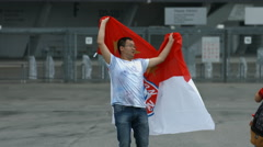 Asian man taking pictures with the FC Bayern Munchen flag, Munich Stock Footage