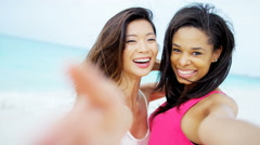 Portrait of smiling multi ethnic female on ocean beach - stock footage
