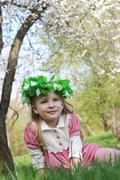 Girl with wreath under spring tree Stock Photos