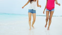 Happy multi ethnic carefree girlfriends on sand - stock footage