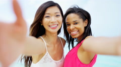 Portrait of African American Asian Chinese girls on beach Stock Footage