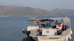Sunshades and View of Marmaris, Sailing Boats, Marmaris, Anatolia, Turkey - stock footage