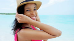 Portrait of happy African American girl in straw hat on beach - stock footage