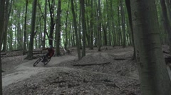 Mountain biker taking steep turns in a forest. Stock Footage