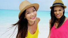 Portrait of African American Asian Chinese girls with hat on beach Stock Footage