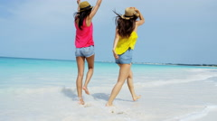 Happy multi ethnic girlfriends on ocean beach vacation Stock Footage