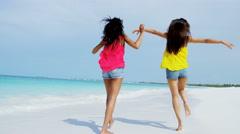 Luxury resort destination smiling multi ethnic female on beach - stock footage