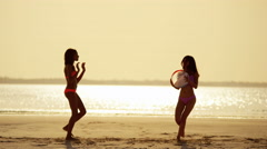 African American Asian Chinese girls on beach at sunset - stock footage
