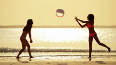 African American Asian Chinese girls on beach Stock Footage
