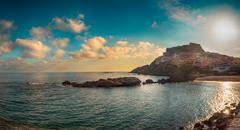 Beach sky sea coast sardinia city castelsardo Stock Photos