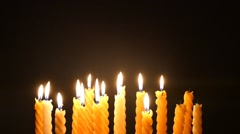 Clandles - Flame - Fire - Candles In The Dark - Light - Religious - Prayer 75 - stock footage