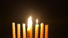 Clandles - Flame - Fire - Candles In The Dark - Light - Religious - Prayer 79 - stock footage