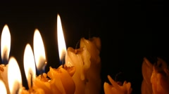 Clandles - Flame - Fire - Candles In The Dark - Light - Religious - Prayer 86 - stock footage