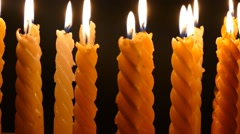 Clandles - Flame - Fire - Candles In The Dark - Light - Religious - Prayer 87 - stock footage