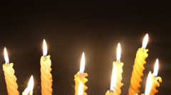 Clandles - Flame - Fire - Candles In The Dark - Light - Religious - Prayer 89 - stock footage