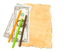 Dollar banknotes and colorful pencil on old paper - stock photo