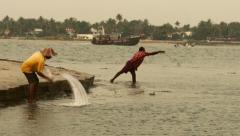 A fisherman throwing his net, Kochi, Kerala, India Stock Footage