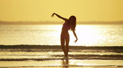 Asian Chinese girl in leisure vacation beach resort sunset - stock footage