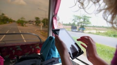 Female Hands Using Tablet While Traveling by Bus in a Trip Stock Footage