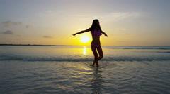 Ethnic female in swimwear on tropical ocean beach - stock footage