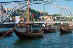 Rabelo boats and bridge of Dom Luis , Portugal Stock Photos
