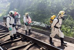 Toxic chemicals emergency rescue people - stock photo