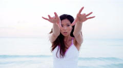 Sexy young Asian Chinese girl with white dress dancing on beach Stock Footage