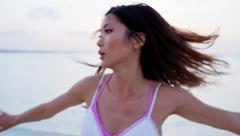 Ethnic Asian Chinese girl on ocean beach Bahamas - stock footage