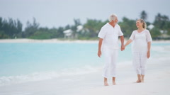 Retired Caucasian senior couple dancing together on a beach - stock footage